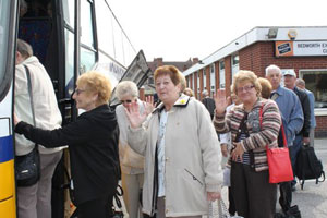 Holidaymakers board the coach 1