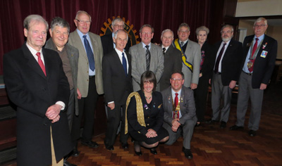 Members of Bedworth Rotary and the DG welcome Lorna to the Club